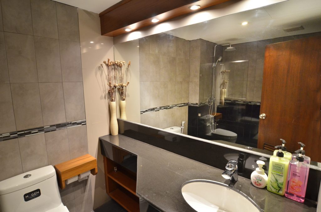 Teak bathroom cupboards, large mirror, good lighting